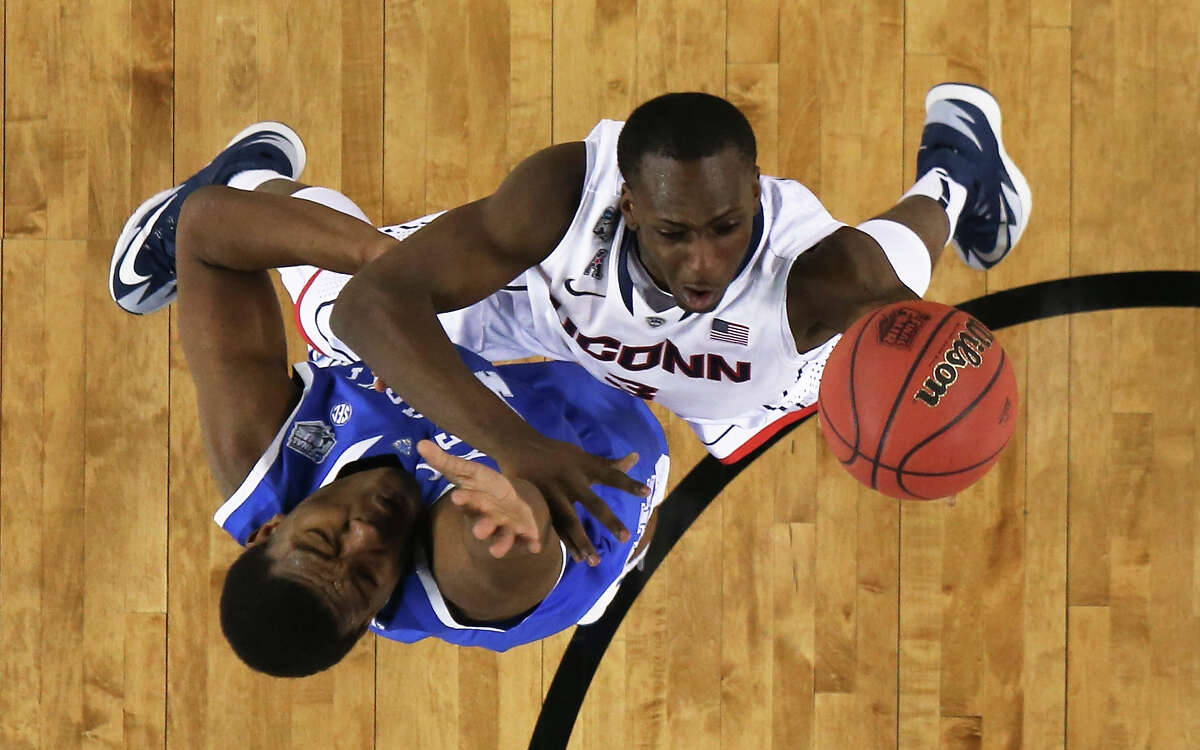 ARLINGTON, TX - APRIL 07: Terrence Samuel #3 of the Connecticut Huskies goes up for a shot as Dakari Johnson #44 of the Kentucky Wildcats defends during the NCAA Men's Final Four Championship at AT&T Stadium on April 7, 2014 in Arlington, Texas.