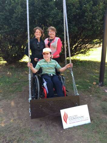 B's Brunch, an annual event that raises money for local non-profits, conducted a fundraiser recently in Troy that resulted in the first handicapped-accessible swing in a park in the city. Shown here are James Laviano, brunch founder Cate McLoughlin-Perry and Susan Kaczynski, development director of the Epilepsy Foundation of Northeast New York.
