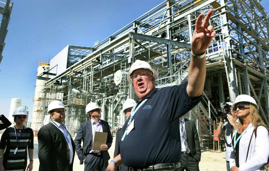 Plant manager Jeff Smith, center, gives a tour of the Capitol SkyMine plant in San Antonio, which will capture 15 percent of the carbon dioxide emissions from the adjacent Capitol Aggregates cement plant. Photo: BOB OWEN, Staff / © 2014 San Antonio Express-News
