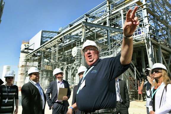 Plant manager Jeff Smith, center, gives a tour of the Capitol SkyMine plant in San Antonio, which will capture 15 percent of the carbon dioxide emissions from the adjacent Capitol Aggregates cement plant.