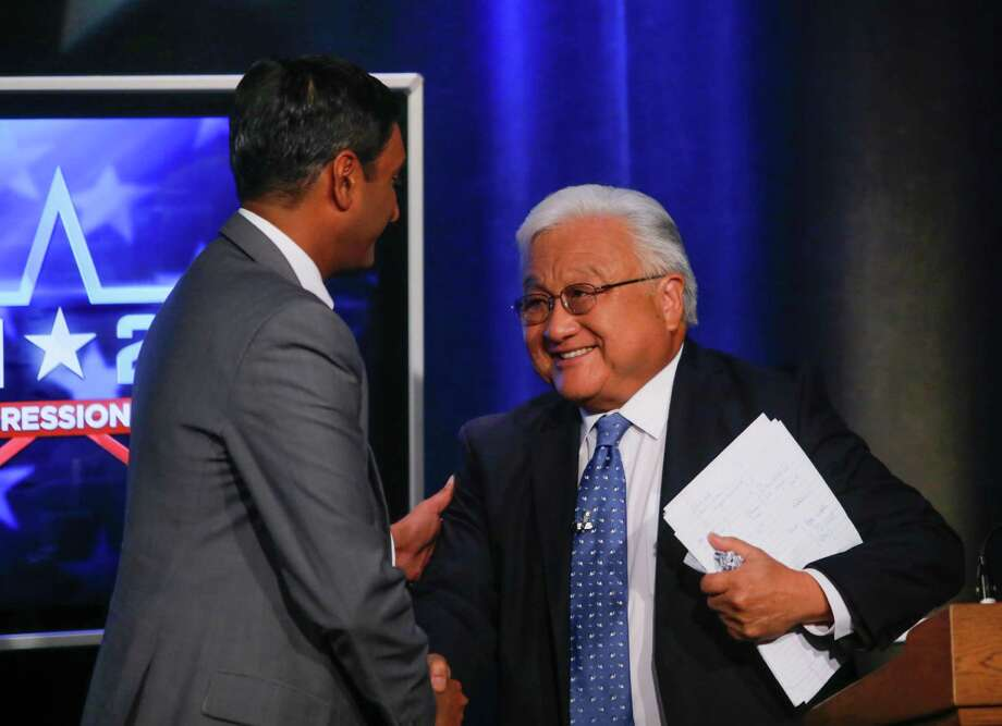 Democratic challenger Ro Khanna, left, and Rep. Mike Honda, D-San Jose, shake hands after their general election debate at KNTV NBC 11, in San Jose, Calif., on Monday, Oct. 6, 2014. (AP Photo// Bay Area News Group, John Green) Photo: JOHN GREEN / Associated Press / Bay Area News Group