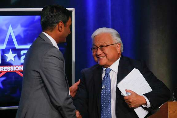 Democratic challenger Ro Khanna, left, and Rep. Mike Honda, D-San Jose, shake hands after their general election debate at KNTV NBC 11, in San Jose, Calif., on Monday, Oct. 6, 2014. (AP Photo// Bay Area News Group, John Green)