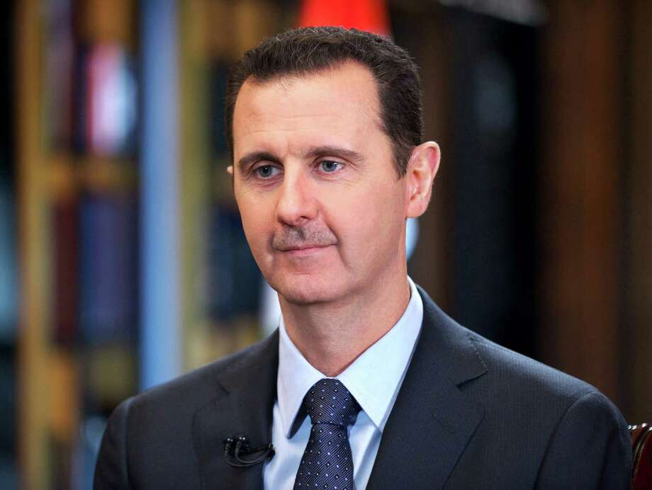 FILE - In this Wednesday, Sept. 25, 2013 file photo released by the Syrian official news agency SANA, Syrian President Bashar Assad speaks during an interview with Venezuela's state-run Telesur network, in Damascus, Syria. Syrian President Bashar Assad is taking advantage of the U.S.-led coalition's war against the Islamic State group to pursue a withering air and ground campaign against more mainstream rebels elsewhere in the country, trying to recapture areas considered more crucial to the survival of his government. (AP Photo/SANA, File) Photo: Uncredited, HOPD / SANA