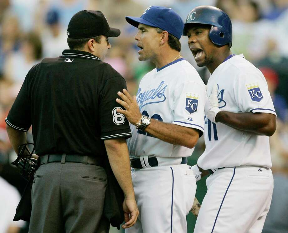Trey Hillman, center, disputing a call in a 2008 game, was the Royals' manager from 2008-10. Two players from that time - Alex Gordon and Billy Butler - remain. Photo: Orlin Wagner, STF / AP