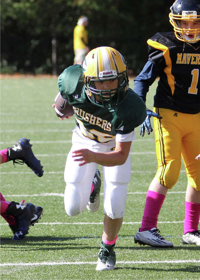 Cos Cob Crushers RB Vincent Ceci blasts through the Mavericks defense in his way to a TD. Photo: Contributed Photo / Greenwich Time Contributed