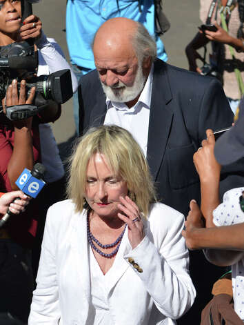 Parents of the late Reeva Steenkamp Barry and June, front, arrive at the court in Pretroia South Africa, Tuesday, Oct. 21, 2104. Oscar Pistorius received a five-year sentence for culpable homicide  for killing girlfriend Reeva Steenkamp last year. (AP Photo/Antoine de Ras, Independent Newspapers)  SOUTH AFRICA OUT ORG XMIT: XDF813 Photo: Antoine De Ras / INDEPENDENT NEWSPAPERS