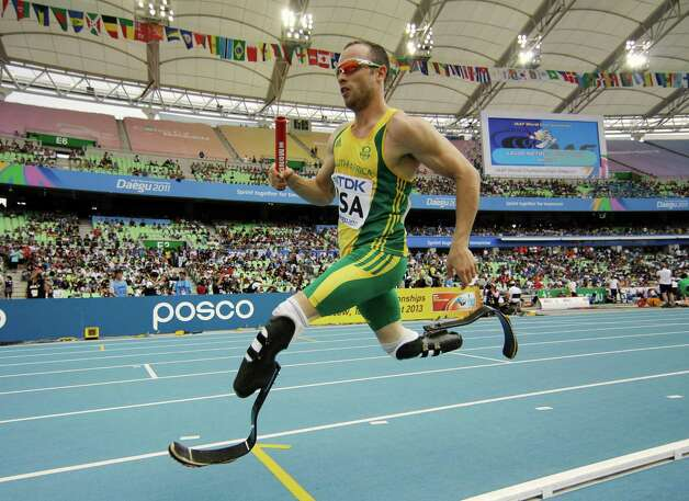 FILE - In this Sept. 1, 2011 file photo, South Africa's Oscar Pistorius competes in a qualification round for the Men's 4x400m relay at the World Athletics Championships in Daegu, South Korea.  Double-amputee Olympic runner Oscar Pistorius has been sentenced to five years in prison for the killing of his girlfriend Reeva Steenkamp. Pistorius, who shot and killed Steenkamp through a toilet cubicle door in his home last year, had earlier been convicted of culpable homicide, or negligent killing. (AP Photo/Matt Dunham, File) ORG XMIT: LTH110 Photo: Matt Dunham / AP
