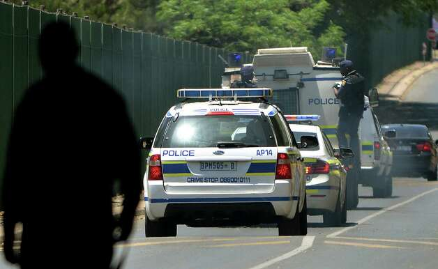 A vehicle believed to be transporting Oscar Pistorius, with police officers hanging on the sides, arrives at the Kgosi Mampuru Correctional Services prison in Pretoria, South Africa, Tuesday, Oct. 21, 2014. Pistorius was sentenced to five years imprisonment by judge Thokozile Masipais for killing his girlfriend Reeva Steenkamp last year. (AP Photo) ORG XMIT: XDF141 / AP