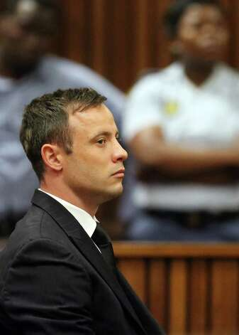 Oscar Pistorius sits in the dock after sentencing in court in Pretoria, South Africa, Tuesday, Oct. 21, 2014. Pistorius was taken away in a police van Tuesday to start serving a five-year prison sentence for killing girlfriend Reeva Steenkamp. (AP Photo/Themba Hadebe, Pool) ORG XMIT: XDF134 Photo: Themba Hadebe / AP POOL