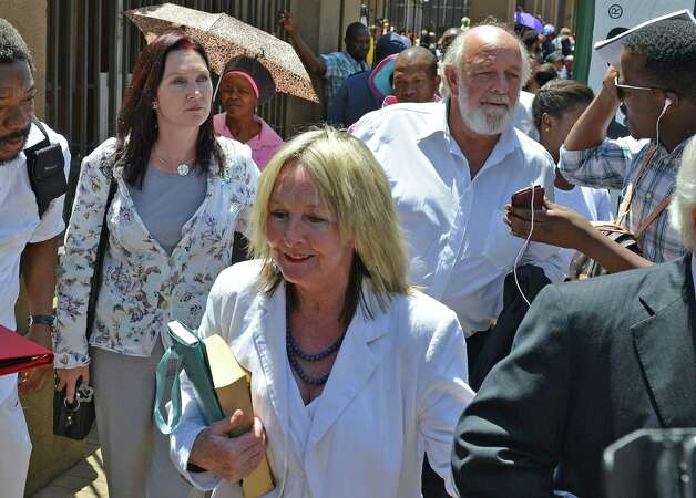 Parents of the late Reeva Steenkamp, June, front, and Barry back, leave court in Pretoria, South Africa, after Oscar Pistorius was handed down a five-year sentence by judge Thokozile Masipais for killing his girlfriend Steenkamp last year.  (AP Photo/Antoine de Ras, Independent Newspapers)  SOUTH AFRICA OUT ORG XMIT: XDF836 Photo: Antoine De Ras / INDEPENDENT NEWSPAPERS