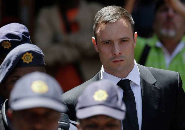 Oscar Pistorius escorted by police officers leaves the high court in Pretoria, South Africa, Friday, Oct. 17, 2014. Following the testimony hearing, Judge Thokozile Masipa is expected to announce Pistorius' sentence on Tuesday after she found him guilty last month of culpable homicide for negligently killing Steenkamp, but acquitted him of murder. (AP Photo/Themba Hadebe) ORG XMIT: XTH106 Photo: Themba Hadebe / AP