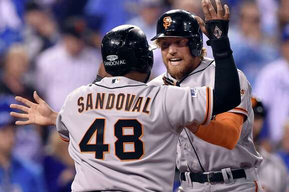 The San Francisco Giants' Hunter Pence is greeted by teammate Pablo Sandoval (48) after Pence hit a two-run home run off Kansas City Royals starting pitcher James Shields in the first inning in Game 1 of the World Series on Tuesday, Oct. 21, 2014, at Kauffman Stadium in Kansas City, Mo. (John Sleezer/Kansas City Star/MCT)