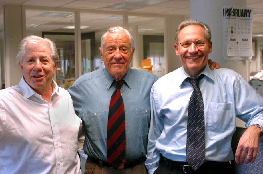 As Washington Post executive editor,  Ben Bradlee guided Carl Bernstein, left, and Bob Woodward in the pursuit of the Watergate scandal. Photo: KATHERINE FREY, MBR / WASHINGTON POST