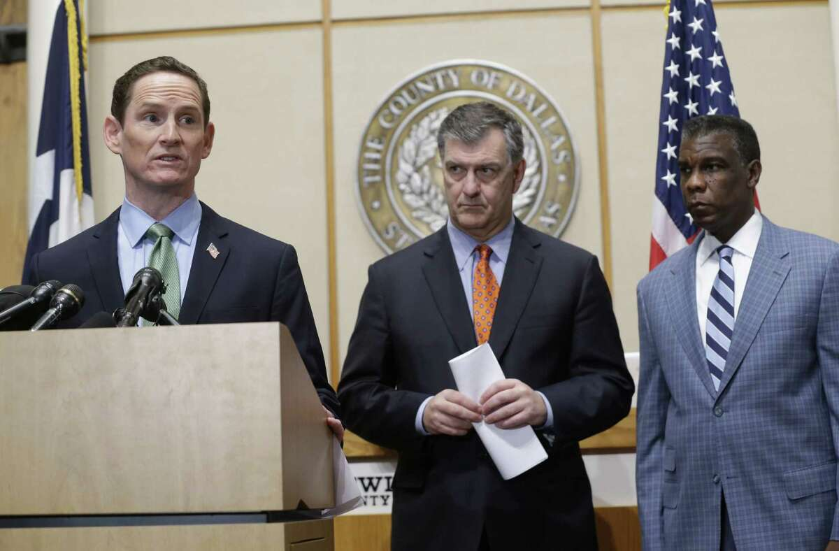 Dallas County Judge Clay Jenkins, left, speaks as Dallas Mayor Mike Rawlings, center, and Director of Dallas County Health and Human Services Zachary Thompson look on during a news conference Monday, Oct. 20, 2014, in Dallas. Ebola fears began to ease for some Monday as a monitoring period passed for those who had close contact with Thomas Eric Duncan, a victim of the disease, and after a cruise ship scare ended with the boat returning to port and a lab worker on board testing negative for the virus. (AP Photo/LM Otero) ORG XMIT: TXMO105