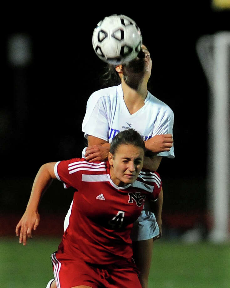 Fairfield Ludlowe's Julia Cheung, top, and New Canaan's Marina Braccio head the ball, during girls soccer action in Fairfield, Conn., on Tuesday October 21, 2014. Photo: Christian Abraham / Connecticut Post