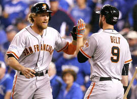 Brandon Belt congratulates Hunter Pence after his two-run, first-inning homer in Game 1 of the World Series.