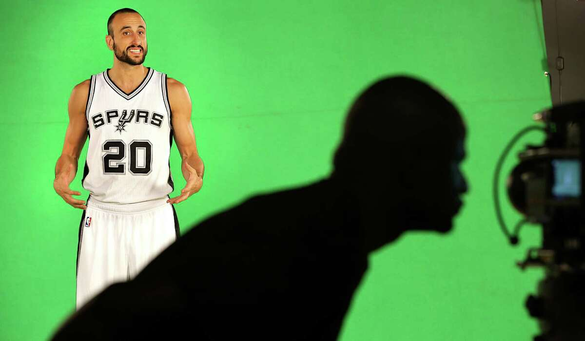 Manu Ginobili smiles as he is videotaped during the San Antonio Spurs hold media day at their practice facility. Friday, Sept. 26, 2014.