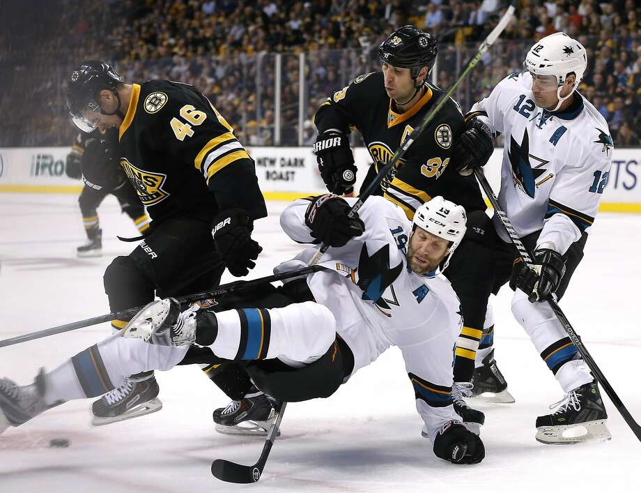San Jose Sharks center Joe Thornton (19) falls to the ice as he vies for the puck with Boston Bruins center David Krejci (46) and defenseman Zdeno Chara (33) as Sharks center Patrick Marleau (12) watches during the second period of an NHL hockey game in Boston, Tuesday, Oct. 21, 2014. (AP Photo/Elise Amendola) Photo: Elise Amendola, Associated Press