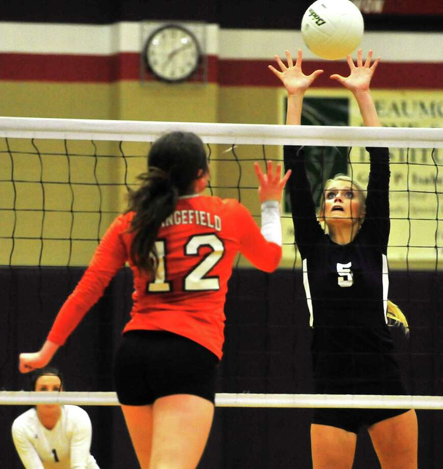 Hardin-Jefferson's Tori Hare goes for the block on the spike by Orangefield's Sabryn Crain during their volleyball match-up Tuesday in Sour Lake. Photo taken Tuesday, October 21, 2014 Kim Brent/@kimbpix Photo: Kim Brent / Beaumont Enterprise