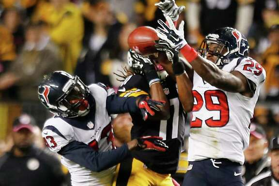 The Texans' lack of execution Monday night included failing to recover an onside kick in the final minute, with  Elbert Mack, left, and Andre Hal, right, having a shot in the air and other players bungling their chances on the ground.