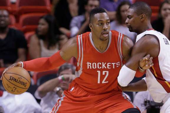 Instead of forming two-thirds of the Rockets' starting frontcourt, Dwight Howard, left, and Chris Bosh were banging into each other Tuesday night.