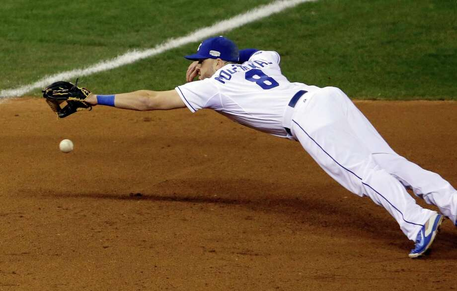 Kansas City Royals third baseman Mike Moustakas can't catch a double hit by San Francisco Giants' Hunter Pence during the fourth inning of Game 1 of baseball's World Series Tuesday, Oct. 21, 2014, in Kansas City, Mo. (AP Photo/Jeff Roberson) Photo: Jeff Roberson, STF / AP