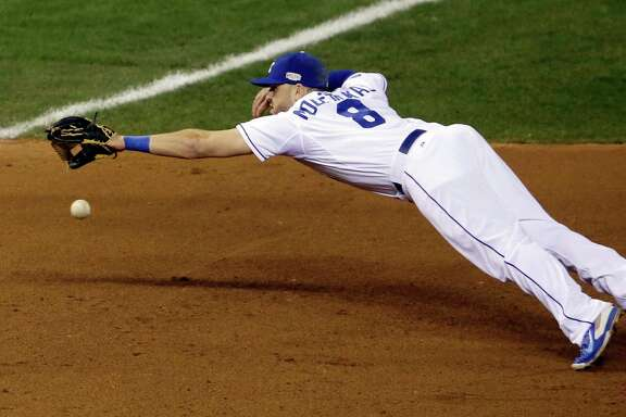 Kansas City Royals third baseman Mike Moustakas can't catch a double hit by San Francisco Giants' Hunter Pence during the fourth inning of Game 1 of baseball's World Series Tuesday, Oct. 21, 2014, in Kansas City, Mo. (AP Photo/Jeff Roberson)