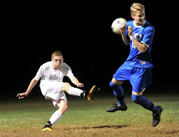Shen's Anthony Romeo, left, sends the ball as Shaker's Tommy Jelstrom blocks during their soccer game on Thursday, Oct. 16, 2014, at Shenendehowa High in Clifton Park, N.Y. (Cindy Schultz / Times Union) Photo: Cindy Schultz / 10029041A