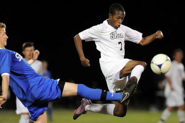 Shen's Malik Sykes, center, takes the ball from Shaker's Tommy Jelstrom during their soccer game on Thursday, Oct. 16, 2014, at Shenendehowa High in Clifton Park, N.Y. (Cindy Schultz / Times Union) Photo: Cindy Schultz / 10029041A