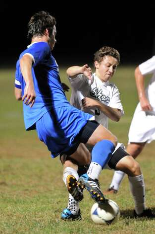 Shen's Michael Miner, right, tangles with Shaker's Greg Milnarik during their soccer game on Thursday, Oct. 16, 2014, at Shenendehowa High in Clifton Park, N.Y. (Cindy Schultz / Times Union) Photo: Cindy Schultz / 10029041A