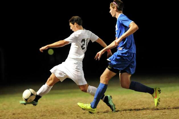 Shen's Tom Osborn, left, controls the ball as Shaker's Kevin Lindsay defends during their soccer game on Thursday, Oct. 16, 2014, at Shenendehowa High in Clifton Park, N.Y. (Cindy Schultz / Times Union) Photo: Cindy Schultz / 10029041A