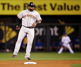 Giants Pablo Sandoval makes it to second base on a wild pitch in the seventh inning during Game 1 of the World Series at Kauffman Stadium on Tuesday, Oct. 21, 2014 in Kansas City, Mo.