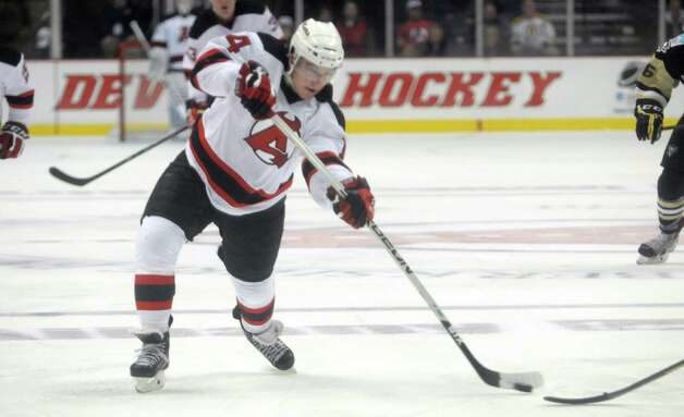 Reid Boucher with the Devils takes a shot on goal during their game against the Penguins on Tuesday, Oct. 21, 2014, in Albany, N.Y.  (Paul Buckowski / Times Union) Photo: Paul Buckowski / 00029136A