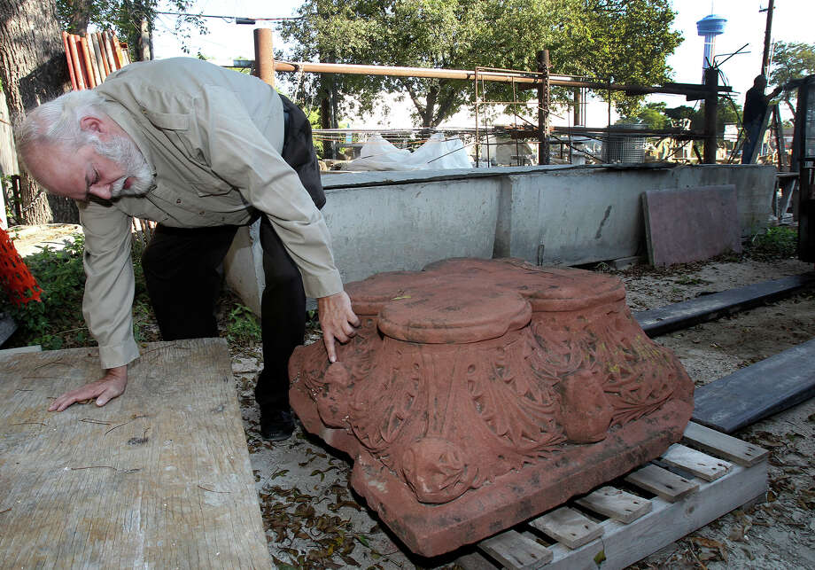 An elaborately carved stone could be an original piece of the Bexar County Courthouse, removed during a 1920s remodeling.For several generations, a quarter-ton piece of carved red sandstone sat behind a South Side monument and tombstone shop.The business owners always knew it might be historically significant, but it wasn't until last week that the stone was revealed to local officials, who now suspect it's an original piece of the Bexar County Courthouse removed about 90 years ago.Read the story only on ExpressNews.com Photo: JOHN DAVENPORT, San Antonio Express-News / ©San Antonio Express-News/John Davenport