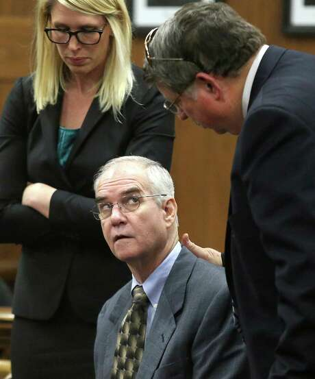 Ed Graf, center, looks at Don Youngblood, right, as defense attorney Michelle Tuegel, left, looks on after pleading guilty to the murder of his two sons during his retrial, Tuesday, Oct. 21, 2014, in Waco, Texas. (AP Photo/Waco Tribune Herald, Jerry Larson) Photo: Jerry Larson, MBO / Waco Tribune Herald