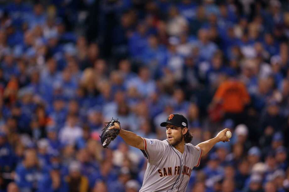 Madison Bumgarner pitches during Game1 of the World Series at Kauffman Stadium on Tuesday, Oct. 21, 2014 in Kansas City, Mo. Photo: Scott Strazzante / The Chronicle / ONLINE_YES