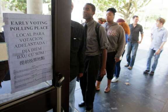 Students from Texas Southern University stand in line at a early voting location after attending a rally encouraging them to get out and vote on Tuesday, Oct. 21, 2014, in Houston.
