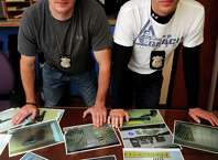 Stamford Police Officers Brendan Phillips, left, and Michael Connelly, right, pose for a photo at police headquarters in Stamford, Conn., on Wednesday, October 22, 2014. The officers' faces are not shown to protect their undercover work.