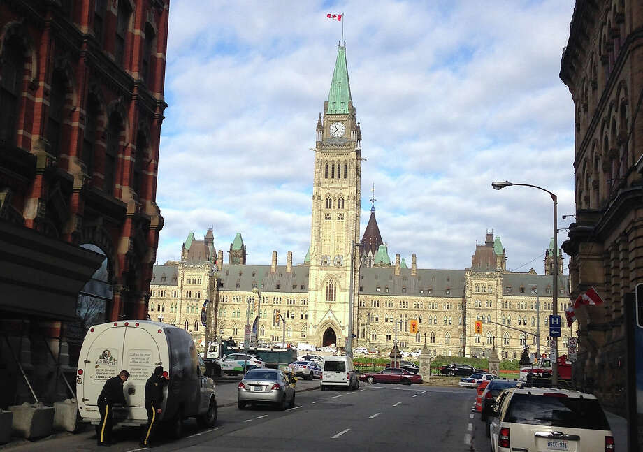 "The Parliament building in Ottawa.  The House of Commons has approved new gender-neutral language to O Canada.  The phrase ""all thy sons command"" in the national anthem is being replaced by ""in all of us command."" Photo: MICHEL COMTE, AFP/Getty Images / AFP"