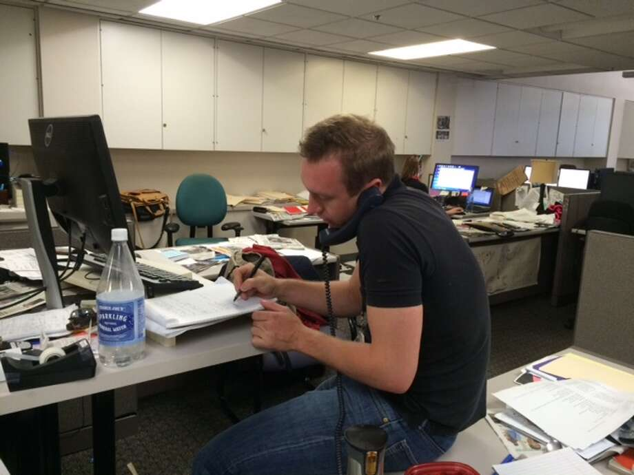 Chronicle reporter St. John Barned-Smith demonstrates the wrong way to use a standing desk.