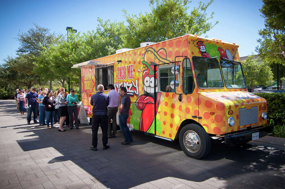 "The ""Taco Me Crazy"" food truck from Rockets owner Tilman Fertitta's Cadillac Bar served volunteers at the Houston Food Bank on Tuesday. Photo: Courtesy Photo"