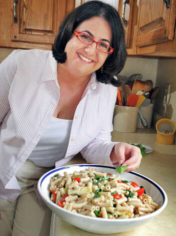 """Elizabeth Barbone's Top Tip for Healthy Cooking: """"It's so basic but really have lots of fresh vegetables, on-hand, that are prepped and easy to get to. I love that fruits and veggies are gluten-free."""" Photo: John Carl D'Annibale/Women@Work / Women@Work Magazine"""