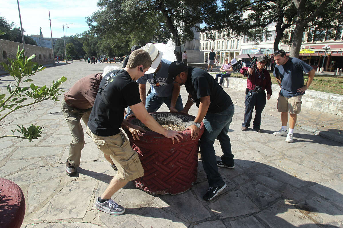 Members of the anti abortion group Created Equal move a planter at Alamo Plaza Wedneday October 22, 2014 that was set in place to block them from bringing in a jumbo tron that would display images of abortion being performed.