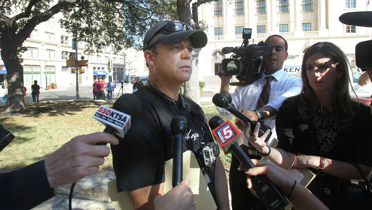 Mark Herrington, National Director of Created Equal, speaks at Alamo Plaza Wednesday October 22, 2014 after speaking with code compliance officials and San Antonio police. The group wants to display anti abortion images on a jumbo tron in front of the Alamo.