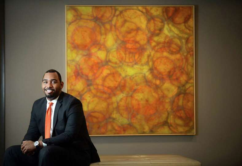 General Manager Tim Simpson sits in the lobby of Hotel Zero Degrees in Norwalk, Conn. in front of a