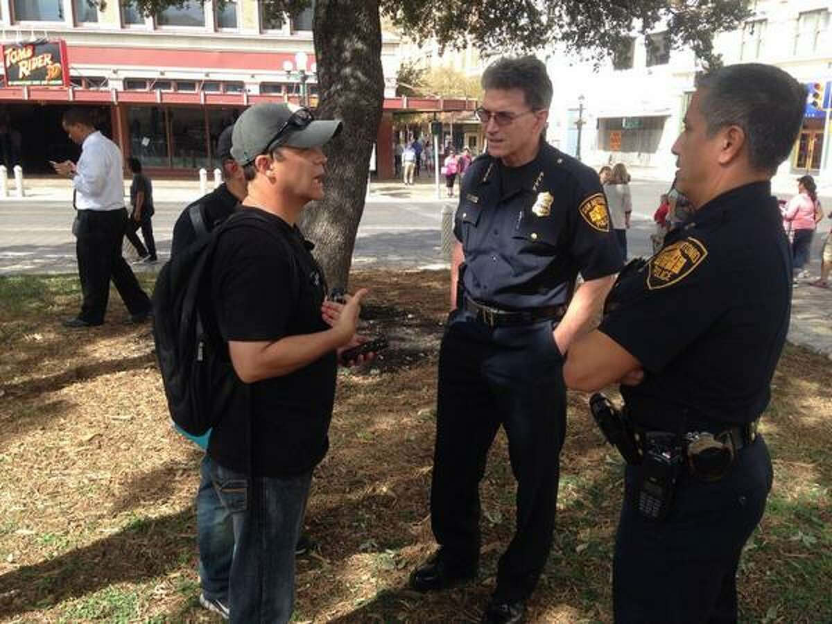 San Antonio Police Chief William McManus (middle) and Mark Harrington, executive director of Created Equal, (left) discuss the anti-abortion group Created Equal's plan for a demonstration that includes projecting video of late-term abortions on a screen near the historic shrine.