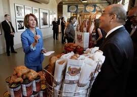"Democratic Leader Nancy Pelosi speaks with small business owner David Wolfgren, before sitting down for a roundtable with local manufacturers, at the Anchor Steam Brewing Co., in San Francisco, Ca., on Thursday September 29, 2011, to discuss the House Democrats' ""Make It In America"" initiative, President Obama's American Jobs Act, and how Congress can best help small businesses grow and hire."