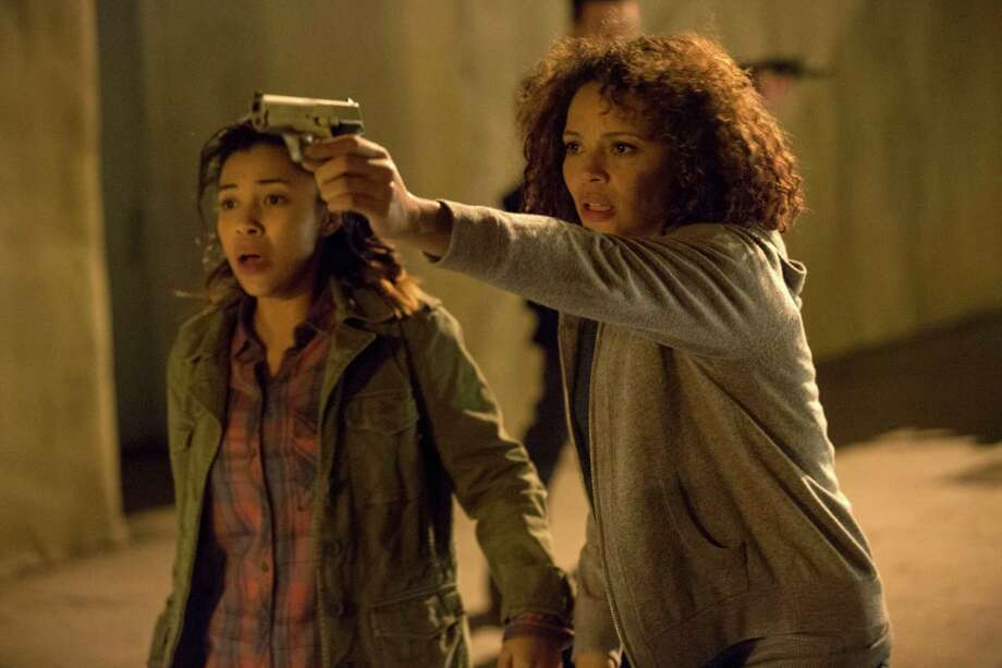 "This image released by Universal Pictures shows Zoe Soul, left, and Carmen Ejogo in a scene from ""The Purge: Anarchy."" (AP Photo/Universal Pictures, Justin Lubin) ORG XMIT: NYET551 Photo: Justin Lubin / Universal Pictures"