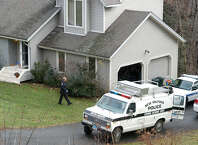 In this file photo, police work at the home on Cortland Drive in New Milford home where 41-year-old Neil Fergus stabbed his estranged wife and attacked his mother-in-law Saturday afternoon. Catherine Fergus, also 41, was in stable condition at Danbury Hospital Sunday. Neil Fergus will be arraigned in court Monday.