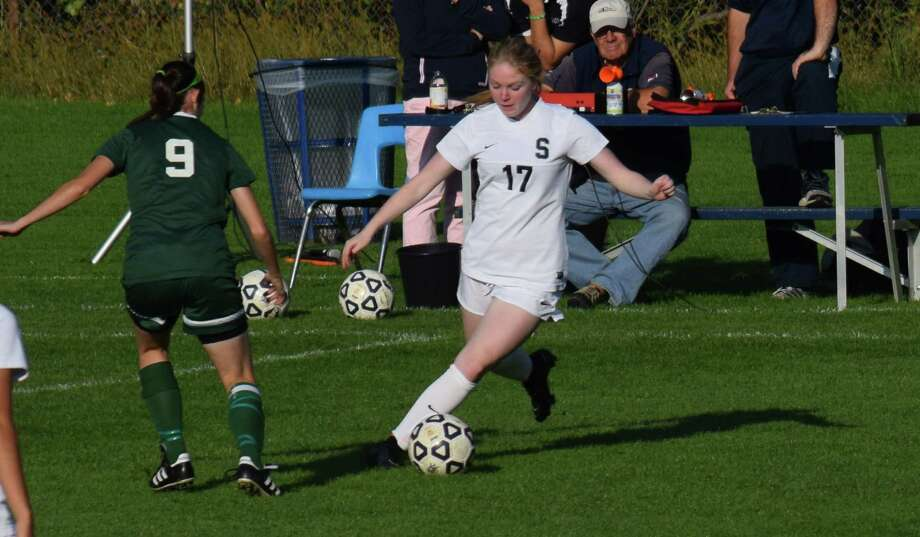 Staples senior Maggie Walsh delivers a long ball forward during a game against Norwalk Oct. 17. The Wreckers won 7-0 on Senior Day to clinch an FCIAC playoff spot. Photo: Contributed Photo / Westport News Contributed